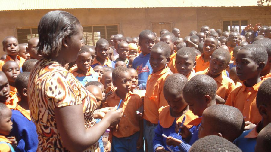 Picture desciription: Photo taken by Pens for Kids Treasurer - Eliza Sikujua with kids